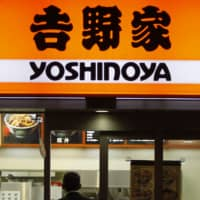 School closures to fight the coronavirus outbreak are exacerbating manpower shortages at retailers and restaurants, including Yoshinoya Co., forcing reduced business hours. | REUTERS