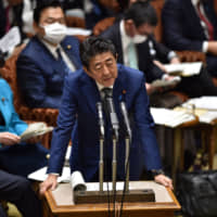 Budget in hand, Abe shifts focus to pandemic response as economy reels