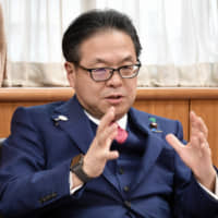 Japanese Cabinet minister says virus may be worse for economy than 2008 financial crisis
