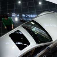 Sales of new Toyota cars, including Lexus models, in China plunged 70 percent in February from a year earlier. | BLOOMBERG