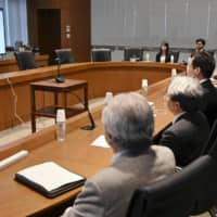 Japanese trade officials visit the South Korean Embassy in Tokyo to hold a teleconference with their South Korean counterparts Tuesday to discuss export controls. | KYODO