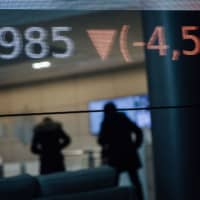 Stock price figures sit reflected in a window in the lobby of the Euronext NV Paris stock exchange in Paris. | BLOOMBERG