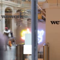 Independent WeWork directors are weighing legal action against SoftBank Group Corp. if it fails to follow through on a rescue package. | BLOOMBERG