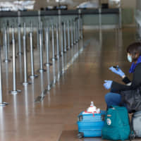 11 flyers amid a sea of seats: Airlines' woes dwarf U.S. aid