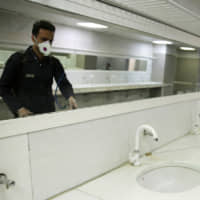 A bathroom is sanitized at the shrine for Imam Reza in Mashhad, Iran. | VIA REUTERS