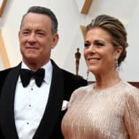 Actor Tom Hanks and wife, Rita Wilson, arrive for the 92nd Oscars at the Dolby Theatre in Hollywood, California, on Feb. 9.   AFP-JIJI
