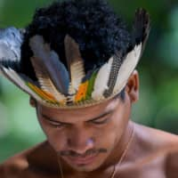 An indigenous man from the Pataxo ethnic group in the village of Nao Xoha, in Brazil's Minas Gerais state, on Wednesday | REUTERS