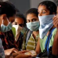 With the deadly new coronavirus now present in 100 countries, companies are unable to match demand for masks. | REUTERS