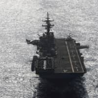 The USS Boxer sails in the Arabian Sea off Oman last July. | REUTERS