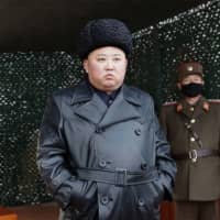 North Korean leader Kim Jong Un inspects a firepower drill at an undisclosed location in this photo released on March 3.   KCNA / KNS / VIA AFP-JIJI