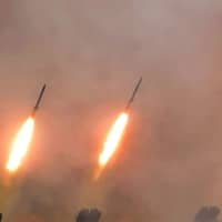 Missiles are seen during a drill by long-range artillery units of North Korea's military in this image released Tuesday. | KCNA / VIA REUTERS