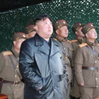 North Korean leader Kim Jong Un observes the firing of apparent ballistic missiles in this image released Sunday. | KCNA / VIA REUTERS