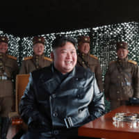 North Korean leader Kim Jong Un observes a demonstration firing of tactical guided weapons at an undisclosed location on Saturday. | AFP-JIJI