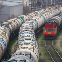 Rail cars for transporting oil at the RN-Tuapsinsky refinery, operated by the Rosneft Oil Co., in Tuapse, Russia, on Monday | BLOOMBERG