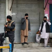 Gunmen in Afghanistan kill 25 in raid on Sikh complex
