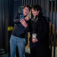 Rory Stewart (right) poses with a member of the public while campaigning in Highgate, north London, last month. | AFP-JIJI