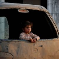 A displaced Syrian girl at an IDP camp near Idlib   REUTERS
