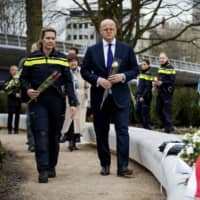 Dutch Minister of Justice and Security Ferdinand Grapperhaus (right) arrives to pay a tribute at the 24th October Square in Utrecht on Wednesday, a year after a tram attack that killed four people. | ANP / VIA AFP-JIJI