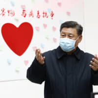 Chinese President Xi Jinping gestures during an inspection of the center for disease control and prevention of Chaoyang District in Beijing in February. | XINHUA / VIA AP