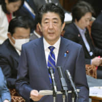 Prime Minister Shinzo Abe explains the government's policy on COVID-19 during a House of Councilors Budget Committee session in Tokyo on Monday. | KYODO