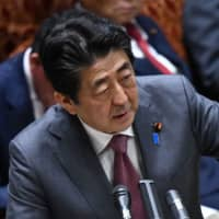 Prime Minister Shinzo Abe answers questions during an Upper House budget committee session at the Diet in Tokyo on Wednesday. | AFP-JIJI