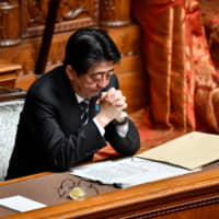 Prime Minister Shinzo Abe attends an Upper House plenary session on Wednesday.   AFP-JIJI