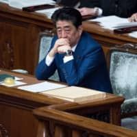 Prime Minister Shinzo Abe's handling of the coronavirus crisis may critically affect the fate of his administration. | BLOOMBERG