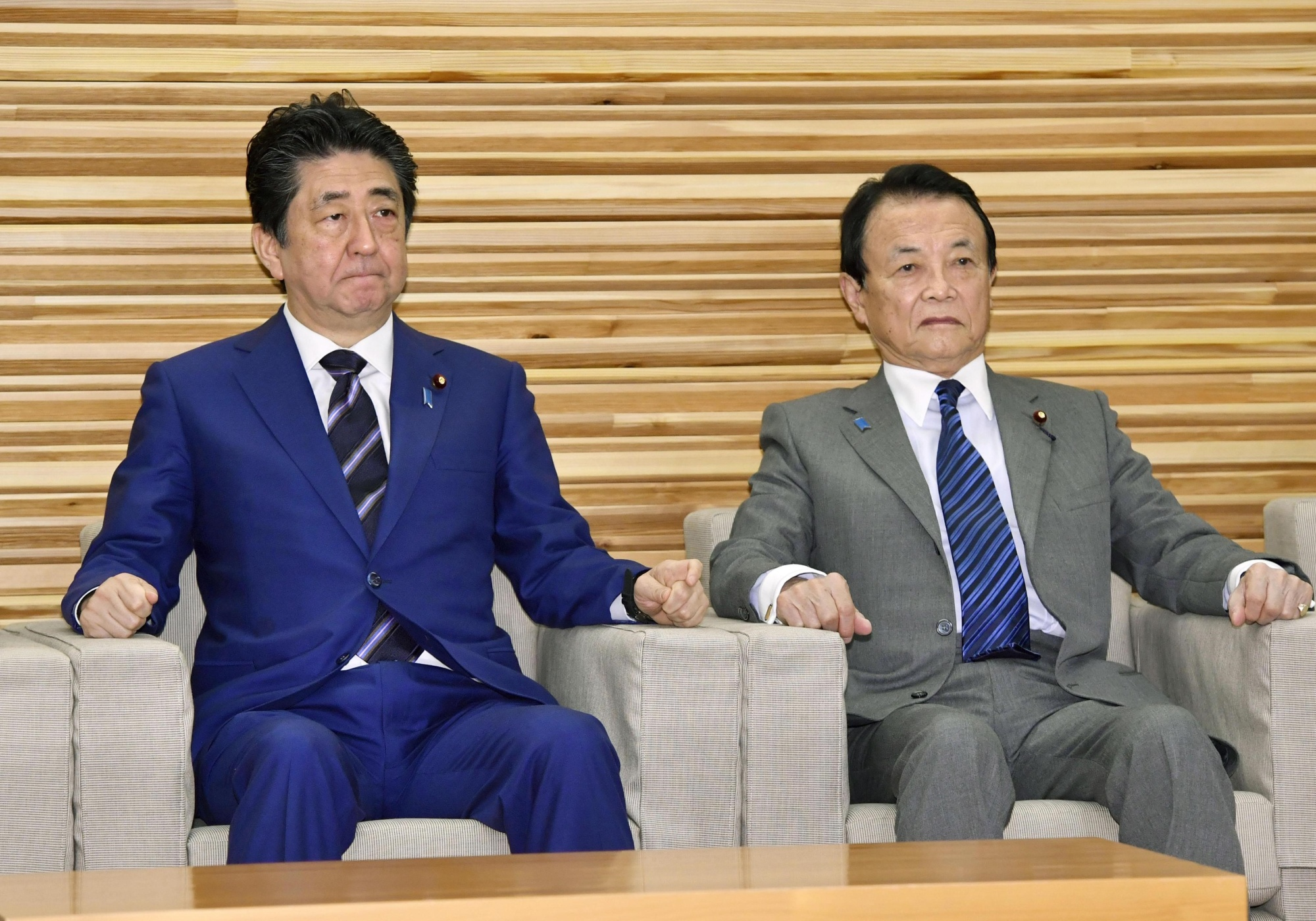 Prime Minister Shinzo Abe and Finance Minister Taro Aso attend a Cabinet meeting in Tokyo on Tuesday.   KYODO