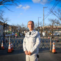 Kiyonori Watanabe, director of Fukushima Electric Power Co., posing outside the 'difficult-to-return' zone in the Yonomori neighborhood of Tomioka, Fukushima Prefecture, says he hopes the region's solar farms will all be taken over by residents, luring additional families home. | BLOOMBERG