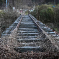 An abandoned railway track stretches past the disused Joban coal field in Iwaki, Fukushima Prefecture. Japan's fossil-fuel crutch that helped the country to keep the lights on after the 2011 nuclear tragedy is making a switch to green energy far harder. | BLOOMBERG