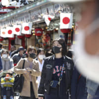 Number of COVID-19 cases in Japan, excluding cruise ship, tops 1,000