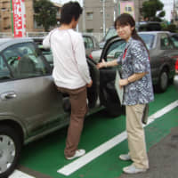 A man takes a lesson at a driving school in Tokyo. Driving lessons for license holders are seeing greater demand as people try to avoid public transportation. | KYODO