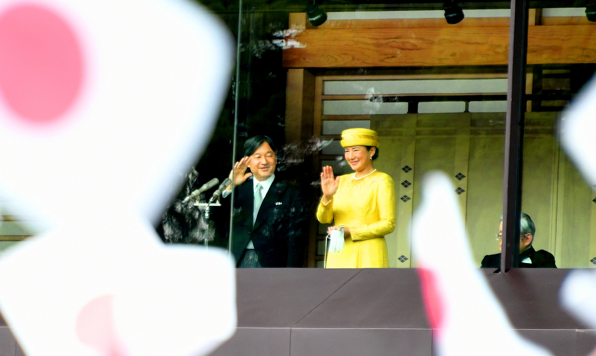 Emperor Naruhito and Empress Michiko wave to well-wishers at the Imperial Palace in Tokyo in May last year. The Imperial Household Agency has canceled a number of public events to protect members of the family from the coronavirus outbreak. | YOSHIAKI MIURA