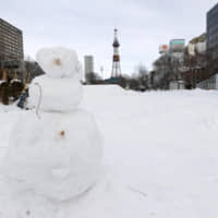 Only a few people are seen walking in Sapporo's Odori Park on Saturday following Hokkaido Gov. Naomichi Suzuki's state of emergency declaration the previous day asking people to stay indoors. | KYODO