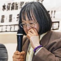 Yukimi Kuramoto, 65, one of the plaintiffs, is at a loss for words during a news conference Friday after the Fukuoka High Court declined to recognize them as sufferers of Minamata disease, rejecting their demand for damages. | KYODO