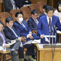 Prime Minister Shinzo Abe speaks during a session of the Upper House Budget Committee on Monday. | KYODO