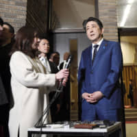 Prime Minister Shinzo Abe speaks to reporters on Tuesday in Tokyo after telephone talks with International Olympic Committee chief Thomas Bach. | KYODO