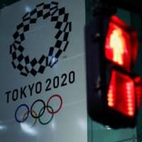 Tokyo organizing exec says he will bring up possible delay of Olympics, stoking confusion
