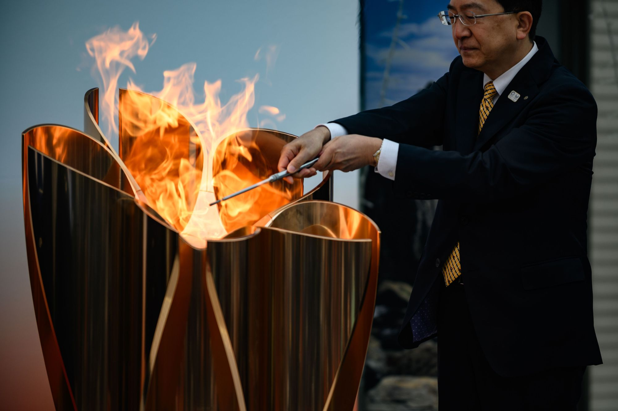 The Tokyo 2020 Olympic flame is displayed outside Miyako Station in Iwate Prefecture on Sunday after arriving from Greece. | AFP-JIJI