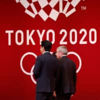 International Olympic Committee President Thomas Bach walks with Prime Minister Shinzo Abe during a ceremony for the Tokyo 2020 Games in the Japanese capital on July 24, 2019. | REUTERS