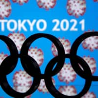 A 3D-printed Olympics logo is seen in front of the words 'Tokyo 2021' in this illustration. | REUTERS