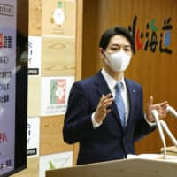 Hokkaido Gov. Naomichi Suzuki speaks at a news conference in Sapporo last Friday after declaring a state of emergency amid a growing number of new coronavirus infections in the prefecture. | KYODO