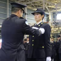 Japan welcomes first female paratrooper