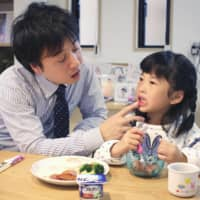 In a survey of 110 large Japanese companies, with responses from 64, about half said their male employees take leave for child care of less than a month. | KYODO