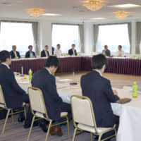 Members of a government panel gather in July 2019 in Tokyo to discuss amending the Copyright Act. | KYODO