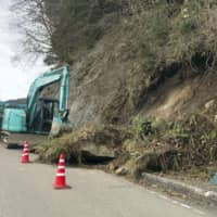 A slope is collapsed along a road in Wajima, Ishikawa Prefecture, on Friday morning after the city was hit by a quake registering an upper 5 out of 7 on the Japanese earthquake intensity scale earlier in the day. | KYODO