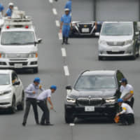 Police examine the site of a road rage incident in Moriya, Ibaraki Prefecture, last August. | KYODO