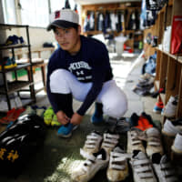 Ryoma Ouchi, 18, who was an ace pitcher on the Fukushima Commercial High School baseball team, prepares for a workout at the clubhouse of the team in Fukushima. | REUTERS