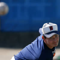 Ryoma Ouchi takes part in a practice on Feb. 21. | REUTERS