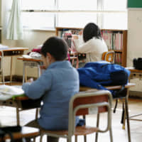 Children who are unable to stay at home during nationwide school closures attend a school to study on their own in Nagoya on March 3. | KYODO